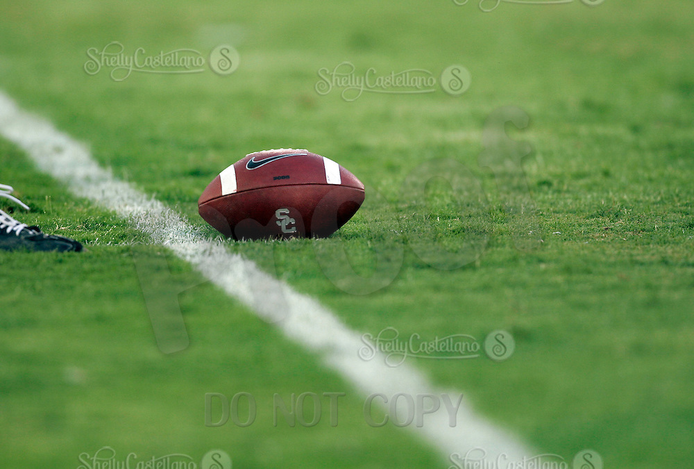 16 September 2006:  Nike USC College Football sitting on green grass graphic detail. Equipment object.