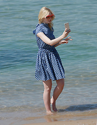 Actress Elle Fanning plays on the beach at the Cannes Film Festival in Cannes, France on May 17, 2017. 17 May 2017 Pictured: Elle Fanning. Photo credit: MEGA TheMegaAgency.com +1 888 505 6342