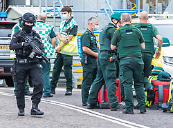 © Licensed to London News Pictures. 19/07/2020. Brighton, UK. Armed police and paramedics outside the Sussex Royal Hospital in Brighton And Hove after one male member of staff was stabbed by a member of the public. Photo credit: Hugo Michiels/LNP