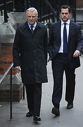 © London News Pictures. 21/11/2011. London, UK.  Max Mosley (left) arriving at The Royal Courts of Justice today (21/11/2011) to give evidence at the Leveson Inquiry into press standards. The inquiry is being lead by Lord Justice Leveson and is looking into the culture, and practice of the UK press. The Leveson inquiry, which may take a year or more to complete, comes after The News of The World Newspaper was closed following a phone hacking scandal. Photo credit : Ben Cawthra/LNP