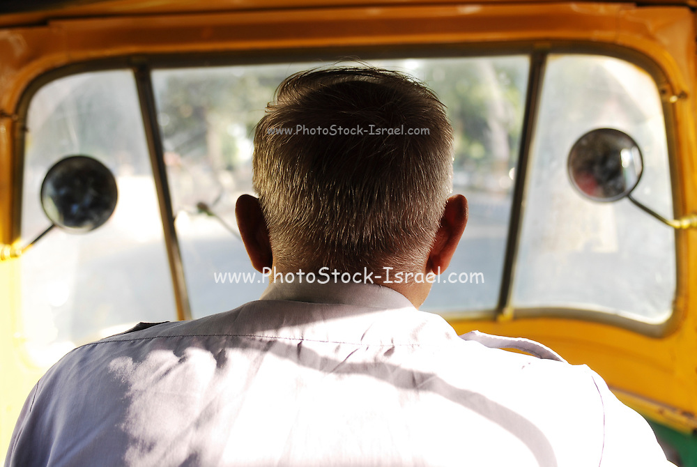 India, Delhi, urban traffic as seen from within a Tuk tuk