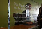 Corporate values statement written onto transparent screens at an auditing company's London headquarters