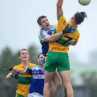 O'Curry's Alex Harvey and St. Senan's Kilkee's Darren Ownes jump to catch the high ball