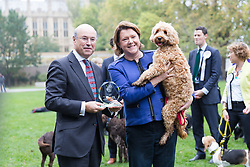 © Licensed to London News Pictures. 26/10/2017. LONDON, UK.  MARIA MILLER MP and her dog, Ted being presented with their prize at the Westminster Dog of the Year Competition held in Victoria Tower Gardens. The Westminster Dog of the Year Competition is organised jointly by the Kennel Club and the Dogs Trust..  Photo credit: Vickie Flores/LNP