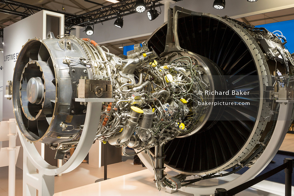 A turbofan jet engine by MTU Aerospace on the company's exhibition stand at the Farnborough Airshow, on 16th July 2018, in Farnborough, England. at the Farnborough Airshow, on 16th July 2018, in Farnborough, England. MTU Friedrichshafen are the makers of engines and propulsion systems with its core business of Rolls-Royce Power Systems, a division of Rolls-Royce plc. Their headquarters are in Friedrichshafen, Germany and we employ over 10,000 people worldwide. (Photo by Richard Baker / In Pictures via Getty Images)