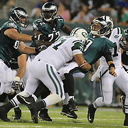 Eagles quarterback Nick Foles is tackled by Antonio Garay after the pass during the first quarter of the New York Jets V Philadelphia Eagles Pre Season NFL match at MetLife Stadium, East Rutherford, NJ, USA. 29th August 2013. Photo Tim Clayton