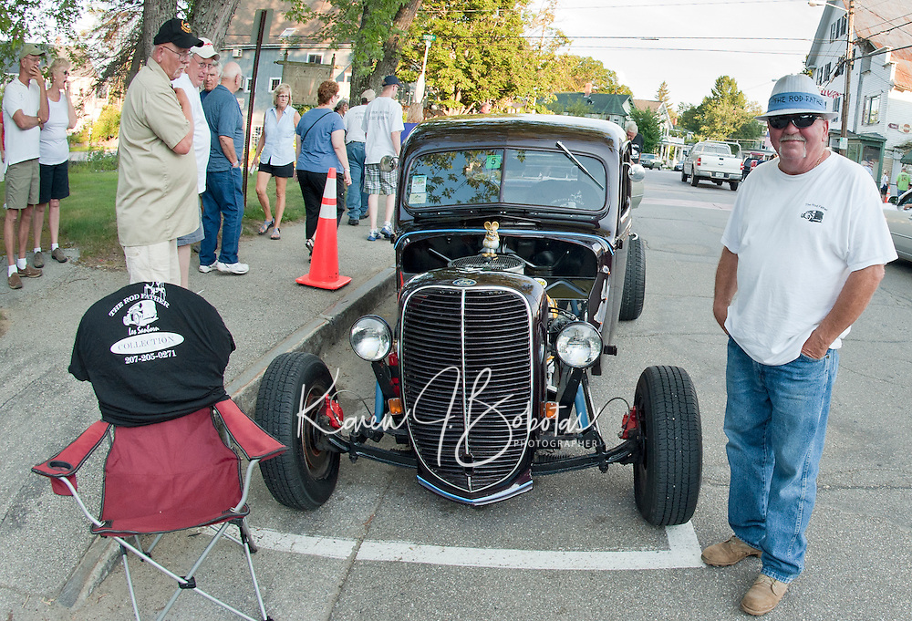 """Les Sanborn better known as the """"Rod Father"""" stands alongside his 1938 Ford Pickup on Main Street in Meredith Saturday evening following the Cruise Night Parade.  Sanborn has a varied collection of 60 cars.  (Karen Bobotas/for the Laconia Daily Sun)"""