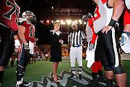 Alaska Governor Sarah Palin participates in the coin toss prior to a Alaska Wild football game.