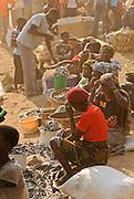 Usipa are sold during a dust storm at Nkhata Bay, Lake Malawi, Malawi.