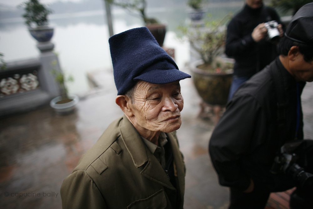 """Hanoi, Vietnam. March 11th 2007..A Vietnamese man in """"Ngoc Son"""", the temple of Jade's mountain"""