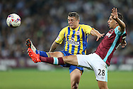 Jonathan Calleri of West Ham United and Scott Brown of Accrington Stanley compete for the ball. EFL Cup, 3rd round match, West Ham Utd v Accrington Stanley at the London Stadium, Queen Elizabeth Olympic Park in London on Wednesday 21st September 2016.<br /> pic by John Patrick Fletcher, Andrew Orchard sports photography.