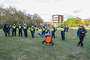 A group of youth drank, smoked and danced in Vauxhall Park following a demonstration against the Policing and Crime Bill in central London on Saturday, May 1, 2021. The Bill is currently making its way through Parliament. The Government claims the legislation is needed to stop disruptive protests but critics claim it undermines free expression. (Photo/ Vudi Xhymshiti)