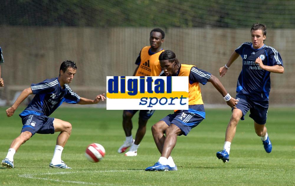 Photo: Daniel Hambury.<br />Chelsea Training Session. The Barclays Premiership. 24/07/2006.<br />Didier Drogba (3rd right) shoots during training.