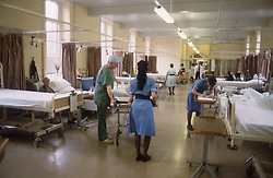 View of hospital ward with nurses and patients,