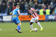 8 Greg Docherty for Shrewsbury Town and Stoke City midfielder Oghenekaro Etebo (8) during the The FA Cup 3rd round match between Shrewsbury Town and Stoke City at Greenhous Meadow, Shrewsbury, England on 5 January 2019.
