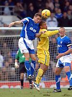 Photo: Ashley Pickering.<br />Ipswich Town v Sheffield Wednesday. Coca Cola Championship. 11/11/2006.<br />Ipswich's Alex Bruce (blue) and Sheffield's Deon Burton