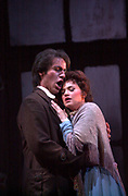 In a sence from act 1 from the Florida Grand Opera production of La bohème. Rodolfo, a poet played by Andrew Richards and Mimi the frail seamstress, preformed by Kelly Kaduce, fall passionately in love on a moonlit Christmas Eve when Mimi comes to him for a light for her candle. Soon, jealousy drives them apart until Rodolfo learns that he may lose Mimi forever. In a moment of truth, the lovers are reunited, only to find themselves eternally separated. La bohème one of the best-loved operas by audiences worldwide is story of youth and never ending love. (El Nuevo Herald Photo/Gaston De Cardenas)