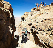 Students on a geology field trip with the University of Colorado gather on the rim of North Caineville Mesa, Utah.