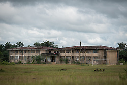 4 November 2019, Vriginia, Liberia: What used to be a junior college at Ricks Institute now sits as a tarnished old building on the grounds, damaged in the times of the latest civil war. The Liberia Baptist Convention runs Ricks Institute, a day and boarding school for currently 496 students from kindergarten up through 12th grade.