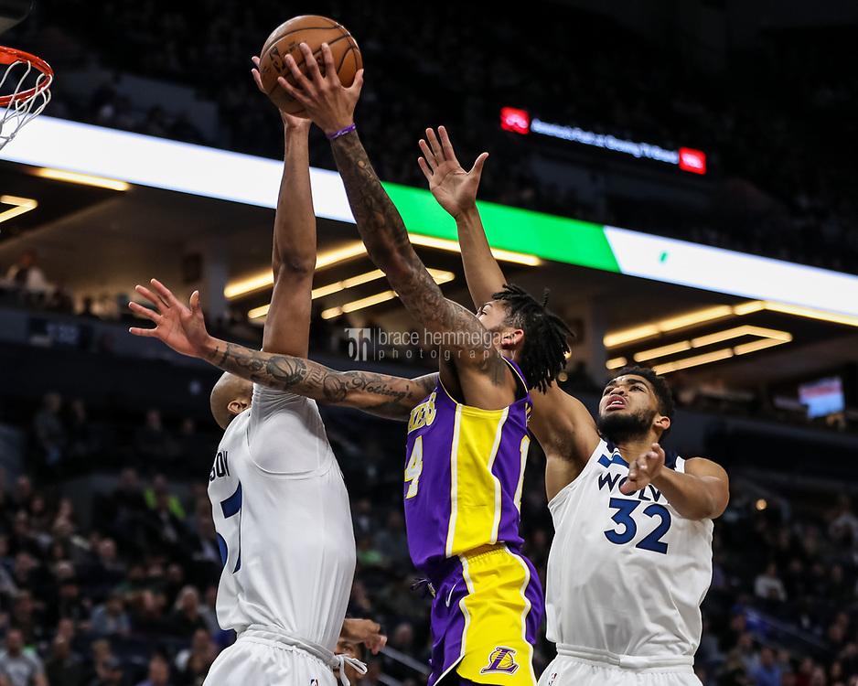 Feb 15, 2018; Minneapolis, MN, USA; Los Angeles Lakers forward Brandon Ingram (14) shoots over Minnesota Timberwolves center Karl-Anthony Towns (32) and forward Taj Gibson (67) during the first quarter at Target Center. Mandatory Credit: Brace Hemmelgarn-USA TODAY Sports