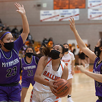 Gallup Bengal Michaela McCurtain (32) drives to the basket as Miyamura Patriots Destiny Bryan (23) and Hali Dennison (10) defend during their varsity basketball game at Gallup High School in Gallup Friday.