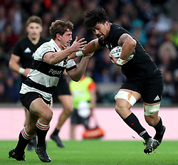 New Zealand's Ardie Savea (right) holds off Barbarian's Kwagga Smith in action during the Autumn International match at Twickenham, London.