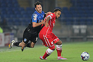 Adam Smith of Bournemouth (left) collides with Nicky Maynard of Cardiff. Capital One Cup, 3rd round match, Cardiff City v AFC Bournemouth at the Cardiff City stadium in Cardiff, South Wales on Tuesday 23rd Sept 2014<br /> pic by Mark Hawkins, Andrew Orchard sports photography.