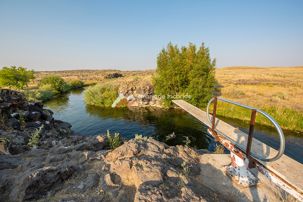 View from above the diving board at the Ledges swimming hole in Richfield, Idaho.