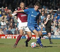 Photo: Ian Hebden.<br />Peterborough United v Northampton Town. Coca Cola League 2. 01/04/2006.<br />Peterboroughs Phil Bolland (R) fends of Northamptons Jason Lee (L)
