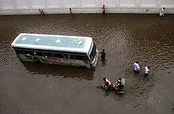 August 2, 2017 - Dhaka, Bangladesh - The road in front of Notre Toyenbee Circular Road went under knee-deep water after Wednesday's rain, in Dhaka, Bangladesh, on August 2, 2017. (Credit Image: © Sony Ramany/NurPhoto via ZUMA Press)