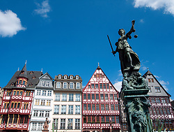 Romer Square with historic timbered houses  and Justitia fountain statue at Frankfurt am Main in old town Germany