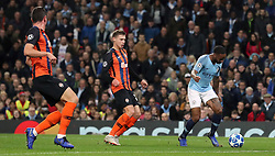 Manchester City's Raheem Sterling (right) goes down inside the box, resulting in a penalty during the UEFA Champions League match at the Etihad Stadium, Manchester.