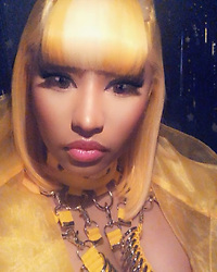 """Nicki Minaj releases a photo on Instagram with the following caption: """"\ud83d\udc87\ud83c\udffc\u200d\u2640\ufe0f\ud83d\udc71\ud83c\udffd\u200d\u2640\ufe0f\ud83d\udc85\ud83c\udffc\ud83d\udc51\ud83c\udf70\ud83c\udf4c\ud83c\udf68\ud83c\udf65"""". Photo Credit: Instagram *** No USA Distribution *** For Editorial Use Only *** Not to be Published in Books or Photo Books ***  Please note: Fees charged by the agency are for the agency's services only, and do not, nor are they intended to, convey to the user any ownership of Copyright or License in the material. The agency does not claim any ownership including but not limited to Copyright or License in the attached material. By publishing this material you expressly agree to indemnify and to hold the agency and its directors, shareholders and employees harmless from any loss, claims, damages, demands, expenses (including legal fees), or any causes of action or allegation against the agency arising out of or connected in any way with publication of the material."""