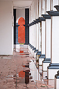 The colonnade of a Caribbean style building in Tlacotalpan, Veracruz, Mexico. The tiny town is painted a riot of colors and features well preserved colonial Caribbean architectural style dating from the mid-16th-century.