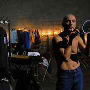 Same-sex dancer Ludwig Becker applies his makeup in the coed dressing area before competing in the adult men's standard division of the same-sex ballroom dancing competition during the 2007 Eurogames at the Waagnatie hangar in Antwerp, Belgium on July 13, 2007. ..Over 3,000 LGBT athletes competed in 11 sports, including same-sex dance, during the 11th annual European gay sporting event. Same-sex ballroom is a growing sports that has been happening in Europe for over two decades.