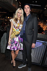 POPPY DELEVINGNE and JAMES COOK at the Wild for WSPA dinner in aid of the charity World Society for the Protection of Animals held at Under The Bridge, Stamford Bridge, Fulham Road, London on 23rd February 2012.
