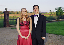Teenage couple standing outside wearing black tie and ball gown,