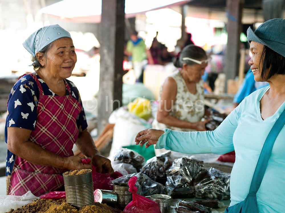 Jilena Pineda (50) shopping at the local market in Esperanza, Sultan Kudarat province, Mindanao Island, The Philippines.