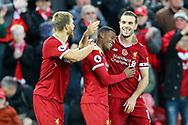 Georginio Wijnaldum of Liverpool (c) celebrates with his teammates after scoring his teams 3rd goal. Premier League match, Liverpool v Huddersfield Town at the Anfield stadium in Liverpool, Merseyside on Saturday 28th October 2017.<br /> pic by Chris Stading, Andrew Orchard sports photography.