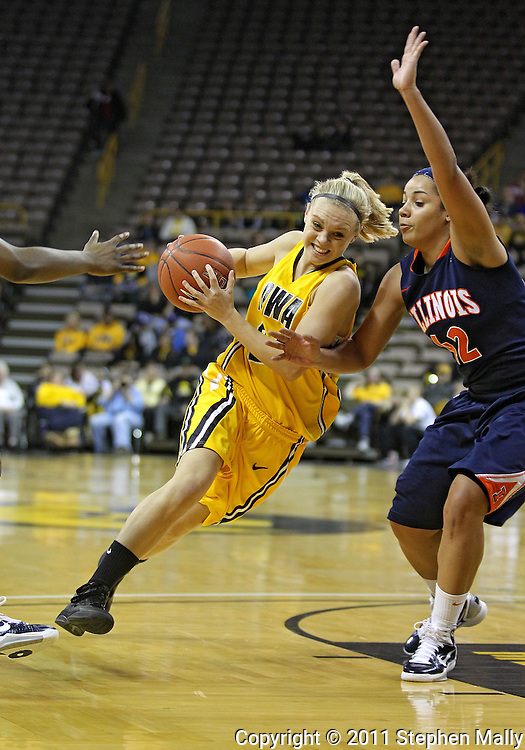 February 24 2011: Iowa Hawkeyes guard Jaime Printy (24) tries to get around Illinois Fighting Illini guard Amber Moore (42) during the first half of an NCAA women's college basketball game at Carver-Hawkeye Arena in Iowa City, Iowa on February 24, 2011. Iowa defeated Illinois 83-64.