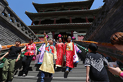 June 1, 2017 - Shenyang, Shenyang, China - Shenyang, CHINA-June 1 2017: (EDITORIAL USE ONLY. CHINA OUT)..Children wearing traditional Manchu clothing experience various games at the Palace Museum in Shenyang, northeast China's Liaoning Province, June 1st,2017. (Credit Image: © SIPA Asia via ZUMA Wire)