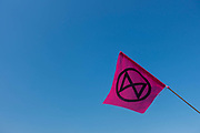 The Extinction Rebellion flag at full mast over Waterloo Bridge as the Extinction Rebellion protests enter their seventh day on the 21st April 2019 in London in the United Kingdom. The environmental campaign group has blocked a number of key junctions in central London in a bid to highlight the ongoing ecological crisis.