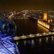 View from the top of the London Eye at night, looking out over the Thames and the Houses of Parliament