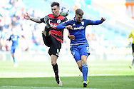 QPR's Grant Hill (l) clears the ball while being challenged by Cardiff City's Anthony Pilkington. Skybet football league championship match, Cardiff city v Queens Park Rangers at the Cardiff city stadium in Cardiff, South Wales on Saturday 16th April 2016.<br /> pic by Carl Robertson, Andrew Orchard sports photography.