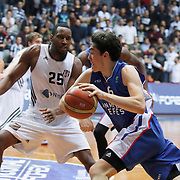 Besiktas integral Forex's Jajuan Johnson (L) and Anadolu Efes's Cedi Osman (R) during their Turkish basketball league match Besiktas integral Forex between Anadolu Efes at BJK Akatlar Arena in Istanbul, Turkey, Monday, January 05, 2015. Photo by TURKPIX