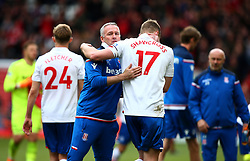 Stoke City manager Paul Lambert (left) hugs Ryan Shawcross at the end of the match
