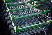Asda supermarket chain trolleys on Old Kent Road on 9th January 2020 in London, England, United Kingdom. Asda Stores Ltd. is a British supermarket retailer, headquartered in West Yorkshire. The company was founded in 1949 and was listed on the London Stock Exchange until 1999 when it was acquired by the American retail giant Walmart for £6.7 billion. Asda was the second-largest supermarket chain in Britain between 2003 and 2014 by market share, at which point it fell into third place. Since April 2019, it has regained its second-place position.