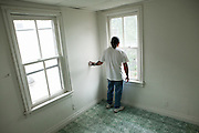 ALLENTOWN, PA – JUNE 16, 2011: Miguel Alfredo-Balcazar surveys a vacant room in a property for sale in Allentown, Pennsylvania.<br /> <br /> As the population of second and third generation Hispanics increases dramatically in the United States, a new boldness can be sensed among Latinos in America, stretching far beyond the southern border states. Demographers in Pennsylvania say the towns of Bethlehem, Allentown and Reading are set to become majority-minority cities, where Hispanics comprise a bigger portion of the population than whites. As this minority population increases dramatically in the region, Latinos are inching closer to their own realization of the American Dream, while gradually shifting the physical and cultural landscapes of their communities.