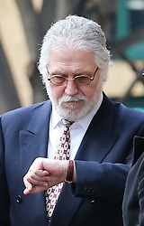 Dave Lee Travis checks his watch at lunchtime outside Southwark Crown Court in London after the jury retired to consider it's verdict , Monday, 10th February 2014. Picture by Stephen Lock / i-Images