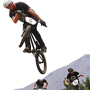 Kane O' Hagan (front), Joe Simpson, (right) and Hugh Wotherspoon in action during the 'Red Bull Roast It' BMX competition with riders from around the globe competing at the Gorge Road Jump Park, Queenstown, South Island, New Zealand. 18th February 2012. Photo Tim Clayton